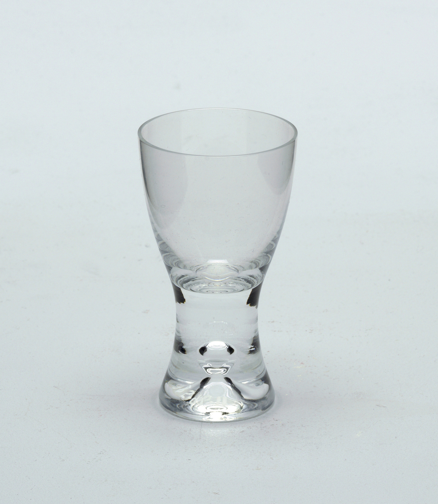 Clear glass with pronounced central air bubble in solid glass stem.  Cordial