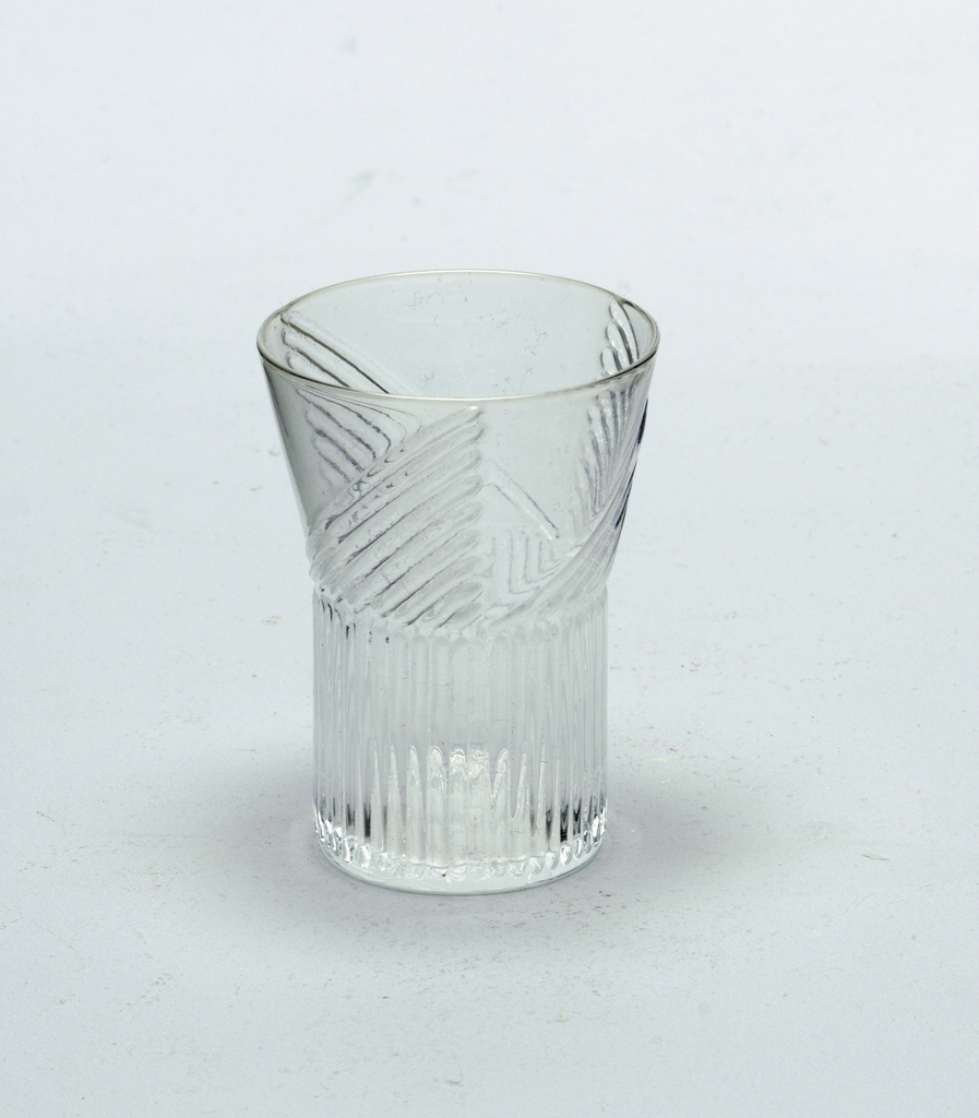 Mold-blown glass with vertical ridge pattern on wide cylindrical stem.  Ridge pattern continues on vessel in a triangular format (3).  Cordial.