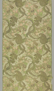 Tan colored silk damask brocaded in green and pink silk with metallic yarns. Brocading bound in twill by warps. Design in the 'bizarre' style shows a pattern of large florals with serpentine chains composed of scrolls. Both selvages persent.
