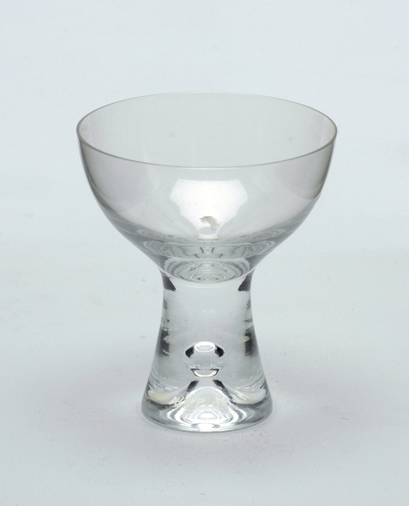 Clear glass with pronounced central air bubble in solid glass stem.  Champagne saucer
