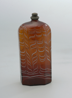 Brown amber glass bottle with opaque white flame pattern.  Square shape with diagonal edges
