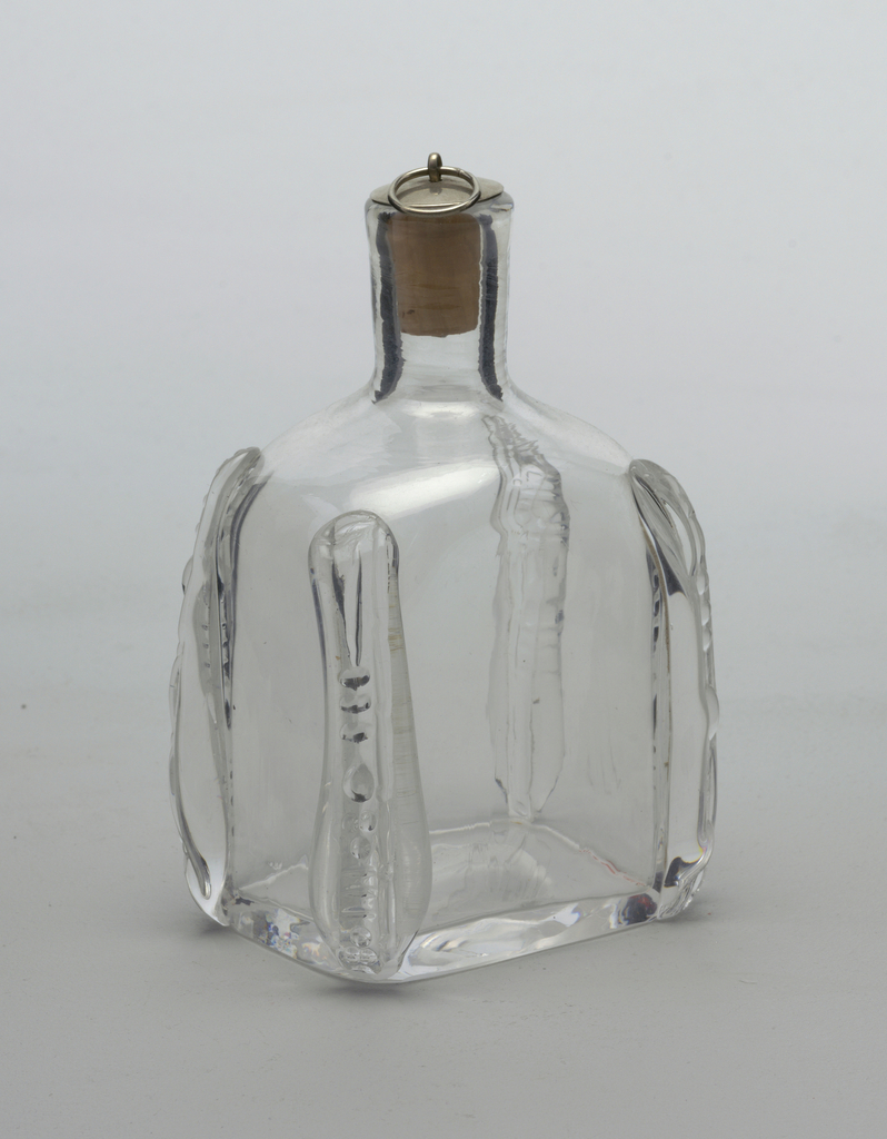 Clear glass rectangular bottle with cork and silver stopper