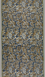 Length of woven silk with densely arranged flowers in brown and silver-gray on a dark blue ground.