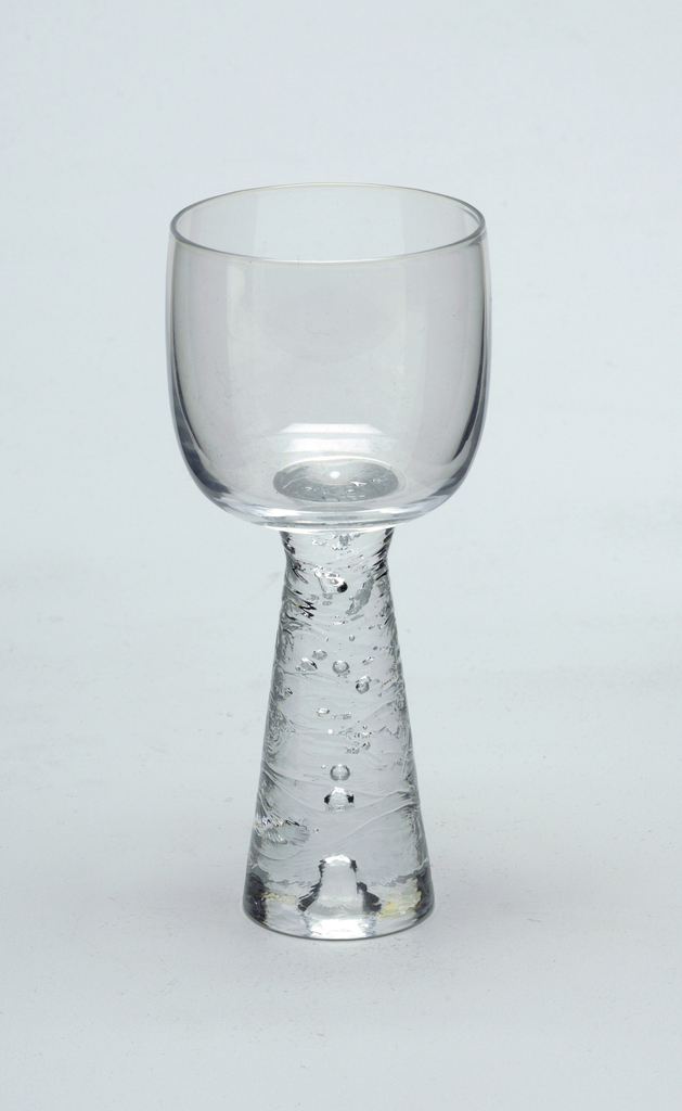 Clear glass with inverted tapered stem with horizontal ridged design.  Red wine