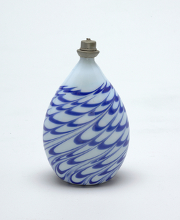 Tear-drop shaped bottle in opaque white glass with slightly blue cast, has horizontal cobalt blue swirling lines.