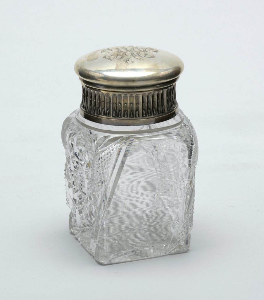 Clear glass jar with silver cover