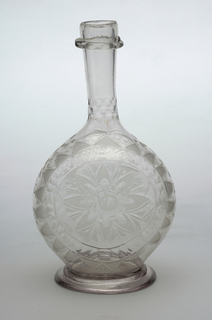 Clear glass decanter, long neck bulbous body with large engraved central flower on body