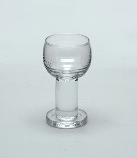 Bell-shaped shot glass with stem and foot.