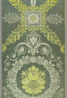 Empire Period lampas in blue and yellow symmetrical design. Large star motif with rosette in center surrounded by a small square frame and scrolls forming a spray in each corner. Below a garland with three roses in center. Scroll forms a triangle above the garland.
