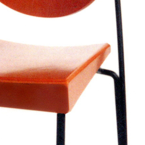 Curved oval back and curved square seat, both of orange-stained wood, on frame of thin black steel rods.