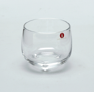 "Bowl shaped glass with 3 feet.  Manufacturer's sticker, red with white ""i"" Made in Finland"