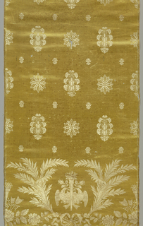 Pale yellow satin with fairly wide set vertical/horizontal repeat of twilled white silk rosettes alternating with anthemion-like forms of leaves radiating from a cone. Small, stylized flower forms fill spaces between these elements. As base of panel in twilled tan and white silk are flambeau flanked with doves addorsed regardant holding rose bud in their beaks and framed with two branches of laurel caught at the bottom with a flowing ribbon bow knot. On either side, partial repeat of flambeau grouped with feathered arrow ends and roses. Two striped satin selvages.