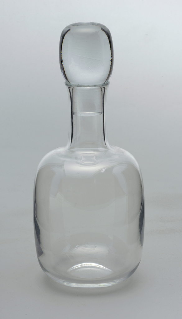Clear glass decanter with large bulbous stopper