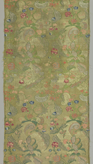 Large pomegranates and baroque scrolls are decorated with colorful small blossoms in shades of blue, rose, pink and green.