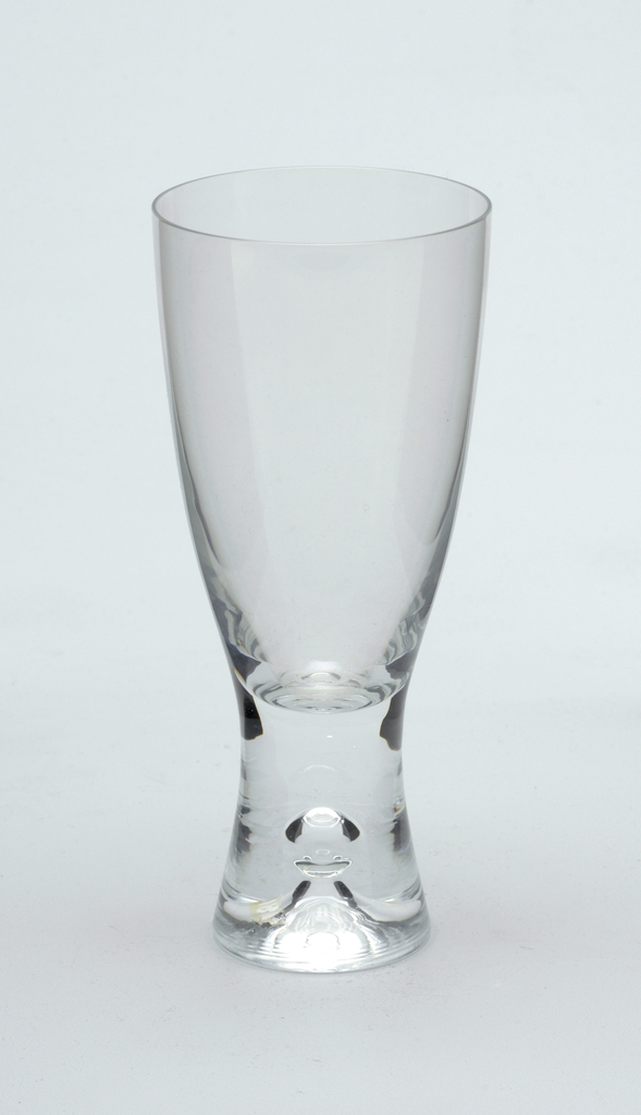 Clear glass with pronounced central air bubble in solid glass stem.  Beer
