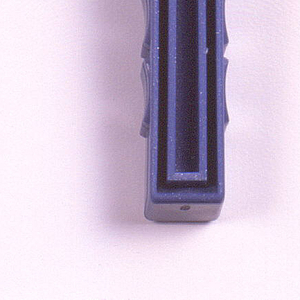 Silver-blue body, with white blade protector at top; deep, hollowed grooves on front, concave elements on sides.