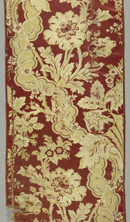 Coral-red satin ground with very large scale floral serpentine pattern in cream and pale green twill.