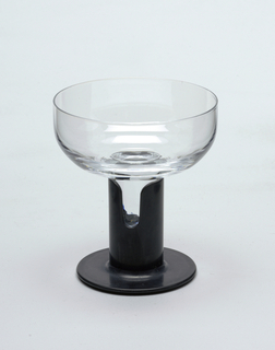 Clear glass cylindrical goblet inserted into white plastic stem.