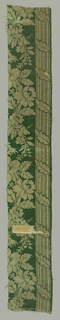 Ivory pattern on green ground with a design of a continuous floral vine between two columns decorated with a spiraling leaf.