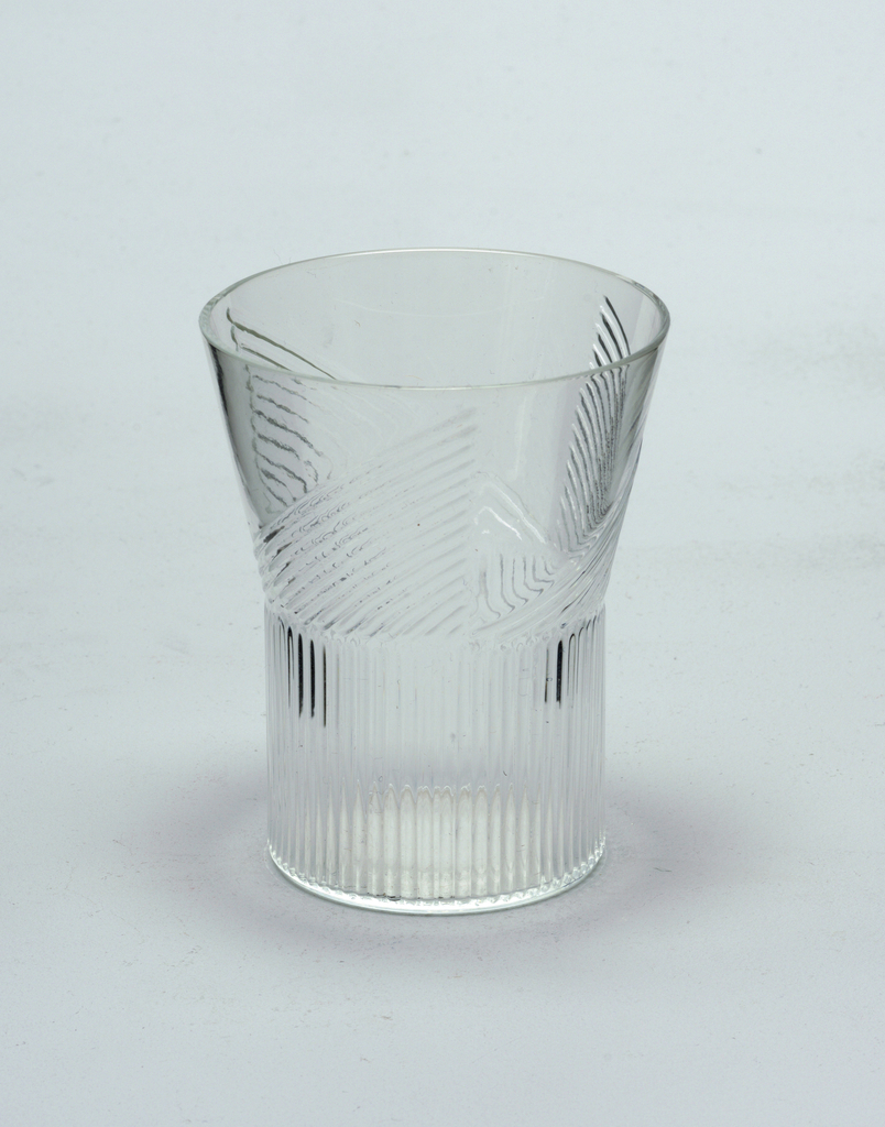 Mold-blown glass with vertical ridge pattern on wide cylindrical stem.  Ridge pattern continues on vessel in a triangular format (3).  White wine.