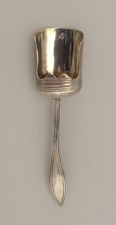 Scoop shaped bowl, reeded on the exterior and with corded tapering stem with pointed terminal.