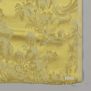 Reproduction textile with an adapted design from the Louis XV period with rocaille work, foliage, blossoms and figures in Chinese costumes. Design inspired by the Cooper Union Museum collection.