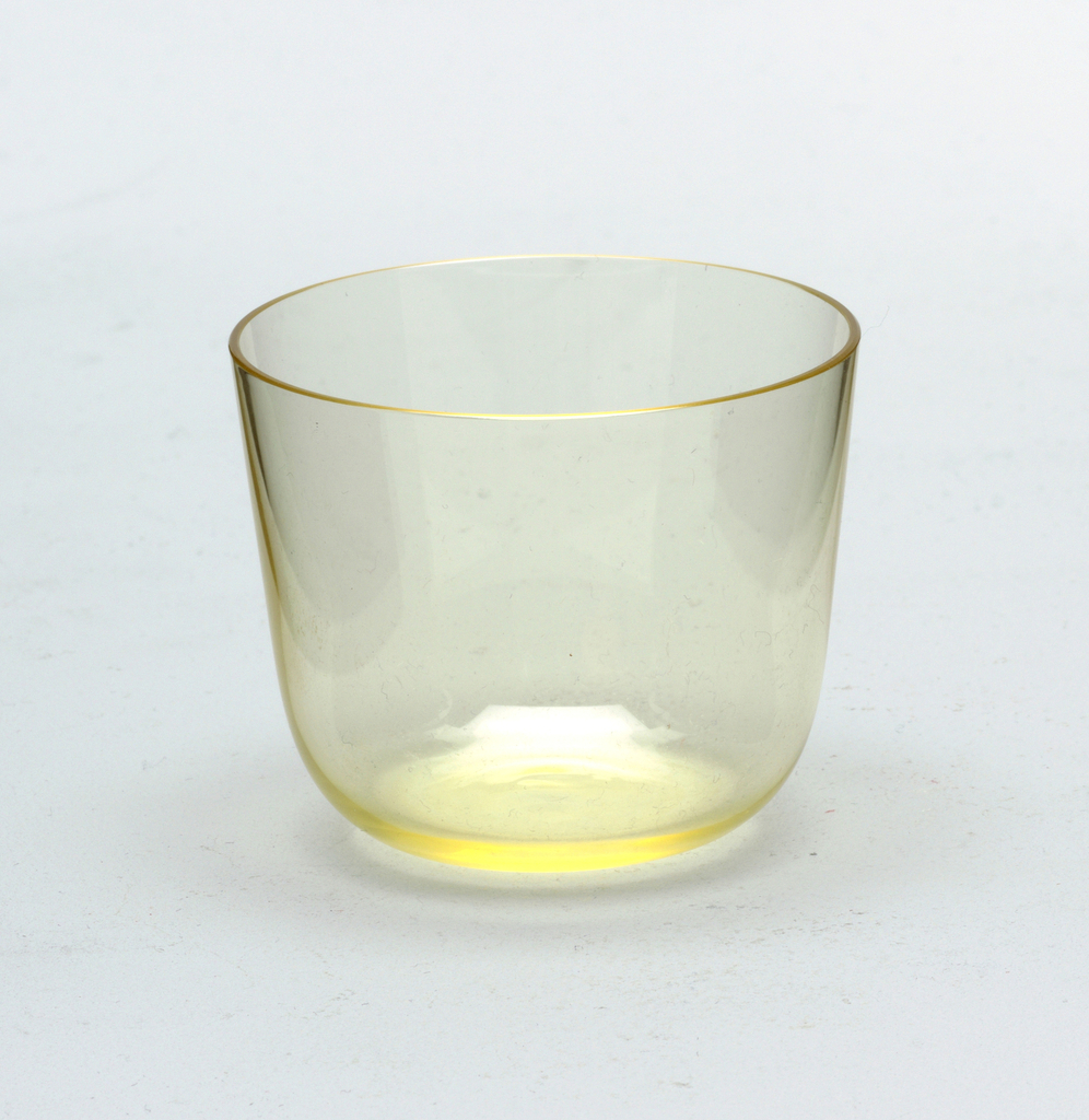 Thin mouth-blown crystal, citrin colored cocktail tumbler.