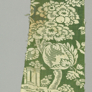Fragment with an archway and tower under an oversized tree with large-scale flowers and fruit in white on a green foundation. Green ground has wide horizontal ribs woven with supplementary green warp.