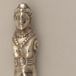 Silver handle in the shape of a female caryatid, handle can be screwed on implement.