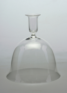 Thin-walled, clear glass; tubular nozzle, flairing at lip and curving into bell-shaped base.