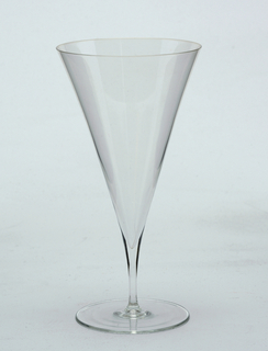 Thin-walled, clear glass; flute-like conical bowl on thin stem and flat circular foot.