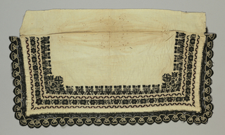 Narrow rectangle of undyed fabric with black and white bobbin lace on three sides and a deep band made up of rows of stylized black silk floral embroidery with elaborated corner motifs. Some cutwork guard borders and open work detail. Faced under embroidery with scarlet wool cloth.