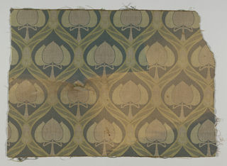 Upholstery fabric in two shades of green. Pattern is an ogival frame enclosing stiff tree form with three pointed leaves. Suggest Art Nouveau style.