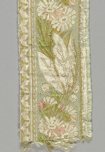 Design of serpentine stem with leaves and flowers with narrow leaf border on one side and other side cut.  Colors: light and dark pink, blue, green, brown, and white.