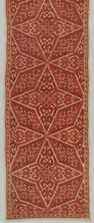 Long rectangular cover showing star-like pinwheels. Red silk on linen.