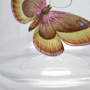 Mouth-blown concave crystal tumbler with painted butterfly.