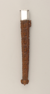 "Carved wooden sheath for two implements. The body of the sheath divided in four vertical parts. Front has six carved biblical scenes, at the bottom an angel holding a shield. On the back six scenes of men feasting, drinking, etc. On the two sides, six apostles with their emblems, ""WGW"" carved on one side, ""1589"" on the reverse.  Plain rectangular silver cap with rounded sides, slides on to sheath (1985-103-42-a). [Replaced?]"