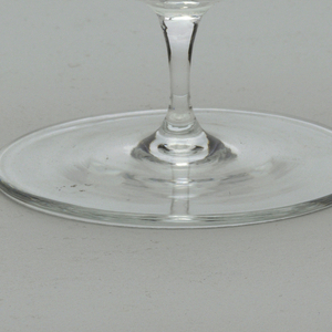 Thin-walled, clear glass; (a) hemispherical bowl supported by thin stem on flat, circular foot; (b) domed cover with spherical knop on stem; rim of cover retracted, to fit snuggly in bowl.