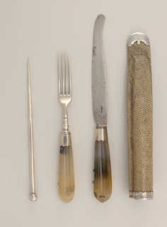 Four-tined fork with curved shoulders. Baluster-shaped neck, octagonal silver ferrule. Handle octagonal in section, tapering towards the top.