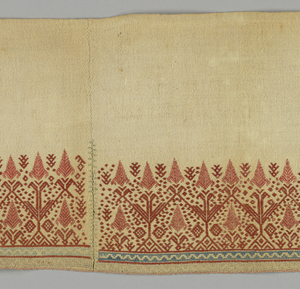 Three pieces stitched together, each patterned by upright symmetrical stylized plants in rust red silk with two narrow geometric borders at botton in blue on yellow; plain undyed linen at top.