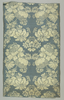 Short panel of blue and white taffeta with a symmetrical pattern of large flowers and fruit clusters.