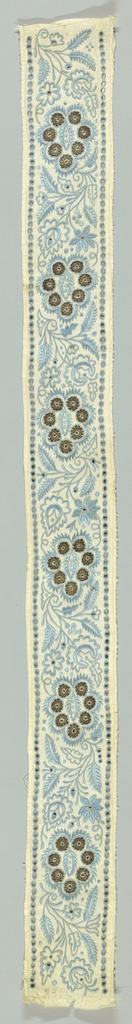 Border in a stylized floral design with cutwork embroidery worked in blue with fillings of metal thread.