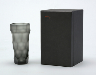 Mouth-blown smoke-grey glass, football cut, semi-polished tapered beaker.
