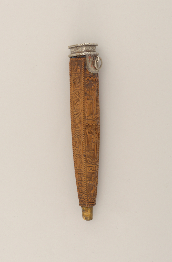 Fruitwood sheath with four curved sides, tapered, carved in relief with biblical scenes. Front: The Creation, Garden of Eden, Resurrection, Jonah (carved IONAS). Reverse: Mary holding infant Jesus, Crucifixion, Baptism (?) of John (?), Jesse (carved IESSE). Sides with twisted border and 6 crowned figures. One side carved with initials W.G.W., reverse with 1555.  Silver lip mount with two slots, lip on one side with small ring attached. Engraved with foliage and twisted wire border. Lacks point mount.