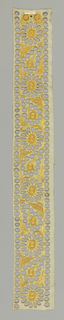 Border in a stylized floral design with cutwork embroidery worked in yellow.