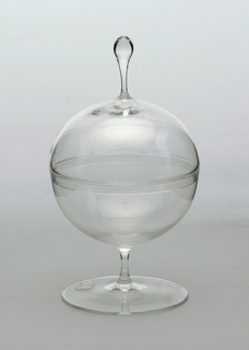 Thin-walled, clear glass; a) hemispherical bowl supported by thin stem on flat, circular foot; b) domed cover with spherical knop on stem; rim of cover retracted, to fit snuggly in bowl.