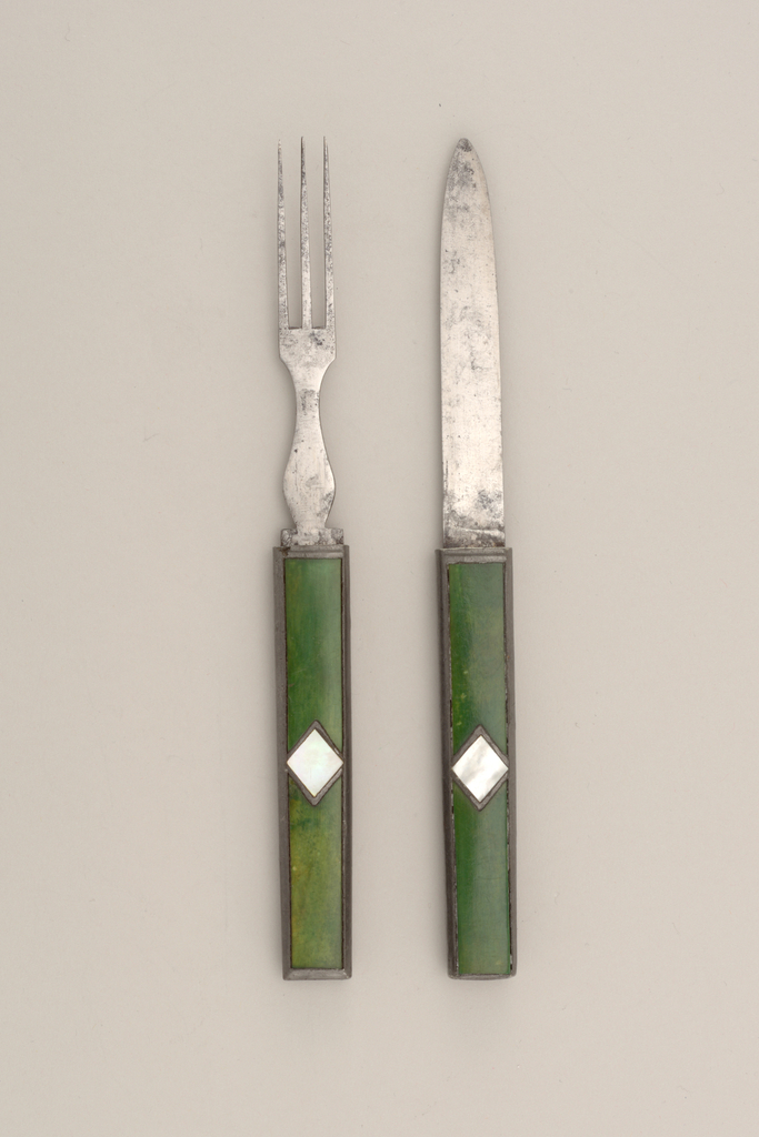 Three flat tines, flat baluster-shaped neck. Rectangular handle with pewter sides. Front and back green painted ivory, inlaid with diamond-shaped mother-of-pearl and pewter in the centre of the handle. Blade of knife slides into handle of fork, tines of fork slide into handle of knife.