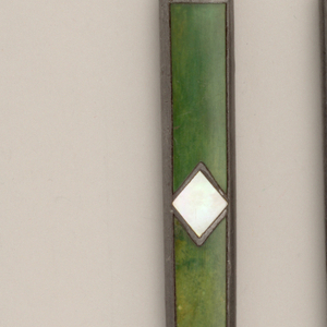 Leaf-shaped knife with straight sides. Flat rectangular handle with pewter sides. Front and back green painted ivory, inlaid with diamond-shaped mother-of-pearl and pewter on the centre of the handle.