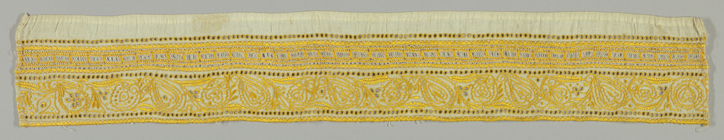 Border in a stylized floral design with cutwork embroidery in yellow. Sicilian filet insertion on one side.