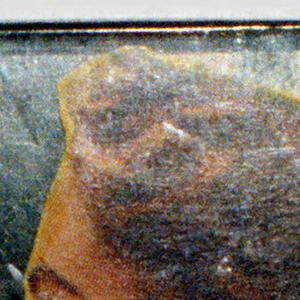 """Square in shape, backed with tape into which metal clasp secured. Montage of printed images with woman's head facing left, """"Mary"""" lower left corner of plexi cover."""